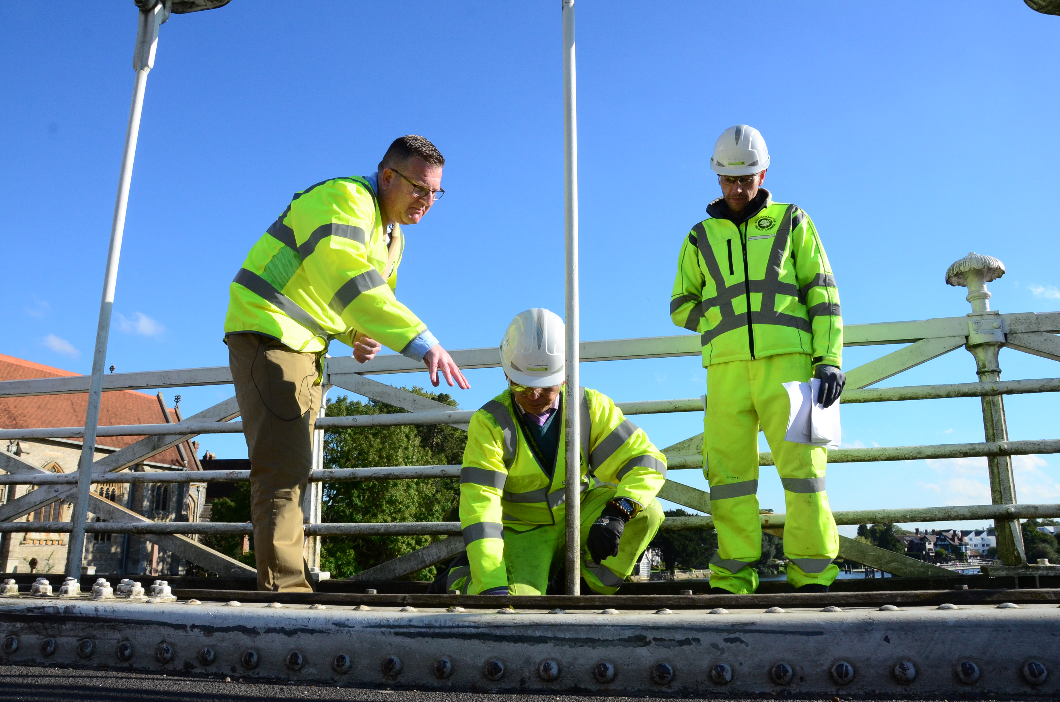 Mark Shaw with structural engineers examining hangers and pins on Marlow Bridge